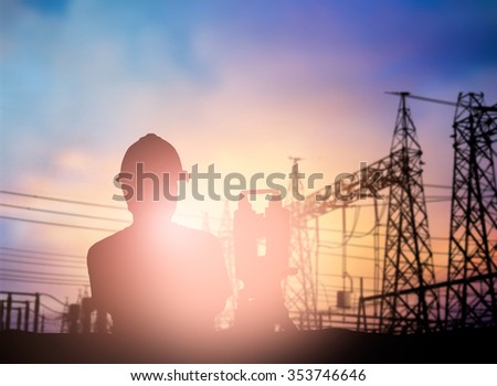 silhouette survey engineer working  in a building site over Blurred construction worker on construction site #353746646