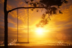 silhouette swing on sunset for alone background