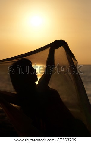 Silhouette take of an oriental dancer  at sunrise