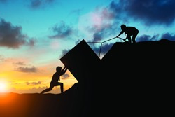 Silhouette team business helps to systematically patience hard work and the pressure to reach the finish line Motivate employee growth concept over blurred natural.