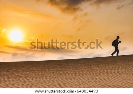 Shutterstock Silhouette traveler walking in the desert on sunset, Mui Ne Desert, Vietnam