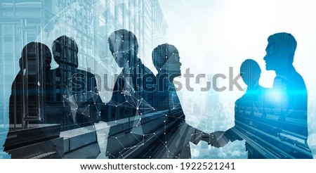 Silhouette view of business people team in group meeting on city office building background showing partnership success of business deal. Concept of teamwork, trust and agreement.