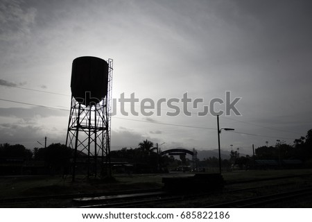 silhouette water tank in the...