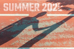 Silhouette woman and tree on asphalt with text summer 2020 concept travel