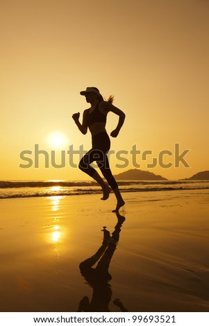 Silhouette woman jogging on the beach