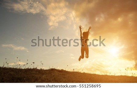 silhouette woman Jump with happy #551258695