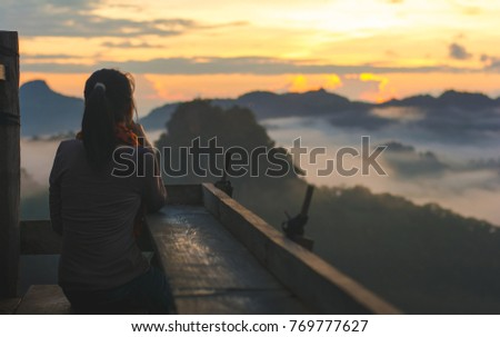 Silhouette woman sitting relax on top of mountain in sunrise ,copy space. - Shutterstock ID 769777627