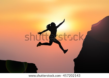 Silhouette women jumping on top mountain #457202143