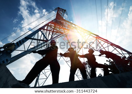 silhouette workers on background of construction stock photo
