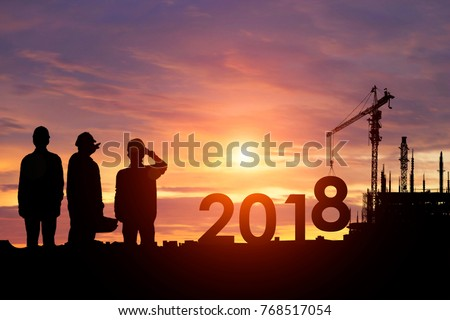 Silhouette workers work constructively to create. 2018 New Year
