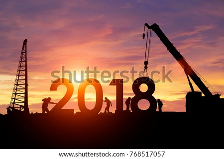 Silhouette workers work constructively to create. 2018 New Year #768517057