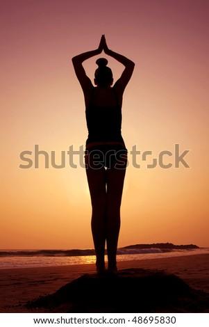 Silhouette yoga meditation pose on beach  - stock photoYoga Meditation Pose Silhouette