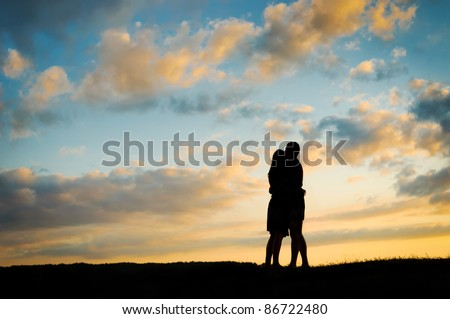 Silhouette young couple  at sunset