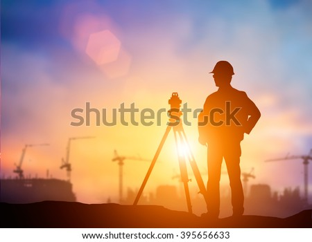 silhouette young engineer working construction standards in line with global construction environment and the environment around the work site. over Blurred construction worker on construction site
