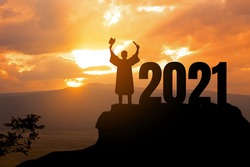 Silhouette Young man Graduation in 2021 years, education congratulation concept ,Freedom and Happy new year, copy space.