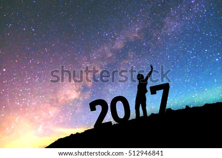 Silhouette young man Happy for 2017 new year background blurred of the Milky Way galaxy on a bright star dark sky tone . #512946841