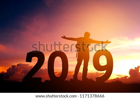 Silhouette young man happy to 2019 new year #1171378666
