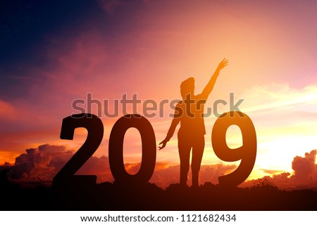 Silhouette young woman Happy for 2019 new year #1121682434