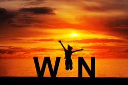 Silhouette young woman jumping on the beach and WIN message, Win concept, celebrating businesswoman success and goals sport exercising and working out.