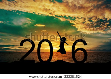 Silhouette young woman jumping on the sea and 2016 years while celebrating new year