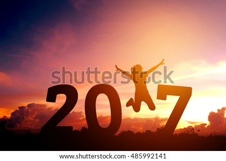 Silhouette young woman jumping to 2017  new year #485992141