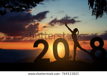 Silhouette young woman jumping to 2018 new year. #764111821