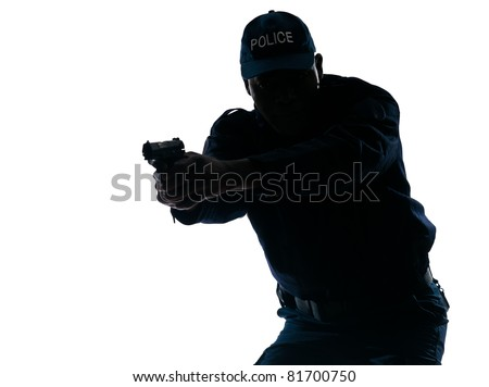 Silhouetted Afro American police officer aiming handgun isolated on white background