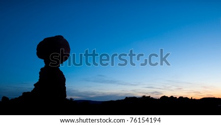 Silhouetted against a beautiful sunset, Balanced Rock in Arches National Park, Utah.
