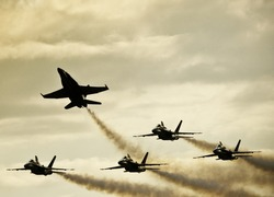 Silhouetted Airplanes on Dramatic Sky