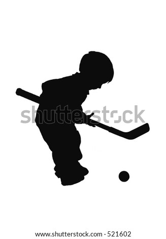 silhouetted boy playing hockey #2