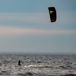 silhouetted Kite surfer in the water