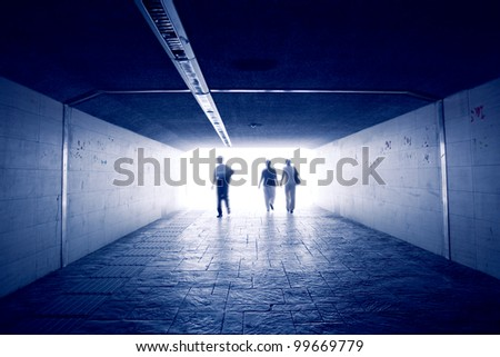 Silhouettes in a subway tunnel #99669779