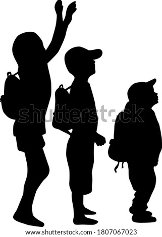 Silhouettes of a children with a backpack .