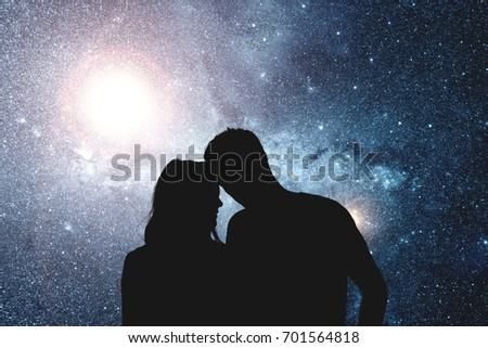 Silhouettes of a young couple under the starry sky. My astronomy work. #701564818