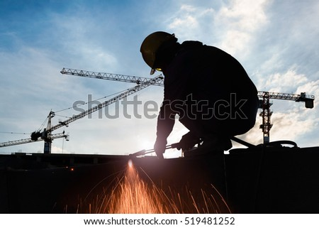 Silhouettes of alienate worker to cutting steel in construction site with Oxy-Propane cutting