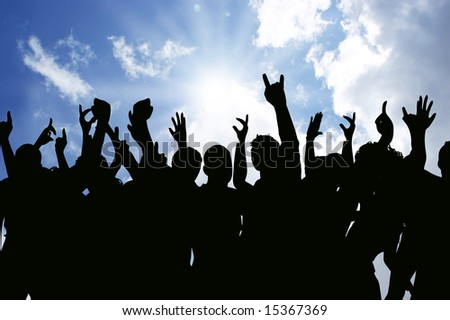 Silhouettes of an excited audience outside