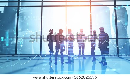 Silhouettes of business people in panoramic Moscow city office with double exposure of blurry digital graph. Concept of stock market and teamwork. Toned image