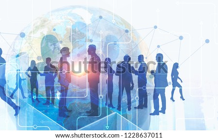 Silhouettes of business people over Earth hologram and immersive interface. Concept of international business. Toned image double exposure Elements of this image furnished by NASA #1228637011