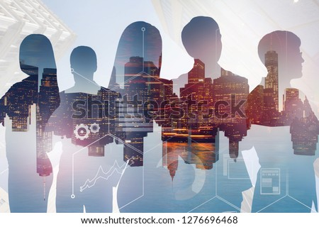 Silhouettes of business people over night cityscape background with double exposure of business infographics. Toned image