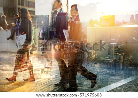 Silhouettes of business people walking in London against of sunset. Multiple exposure image. Business concept illustration.