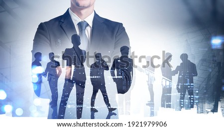 Silhouettes of business people working at corporate office in downtown. Work hard and business development concept. Double exposure