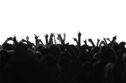 silhouettes of concert crowd in front of bright stage lights, black and white version