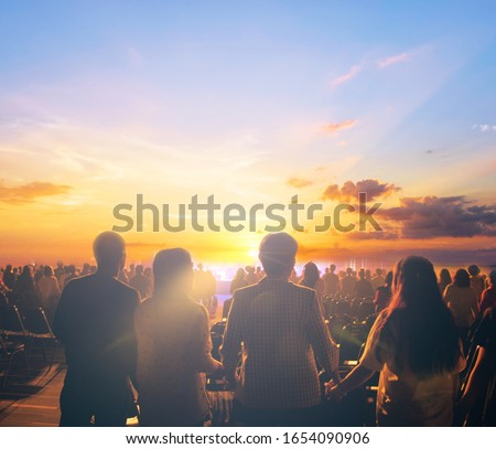 silhouettes of concert crowd in front of sunset background Stock photo ©