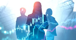 Silhouettes of confident traders working together in abstract city with double exposure of blurry financial graph and digital world map. Concept of teamwork and stock market. Toned image