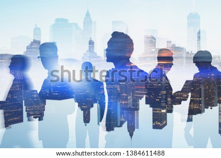 Silhouettes of diverse business people working with documents and discussing work over gray cityscape background. Toned image double exposure blurred #1384611488