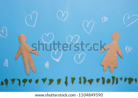Silhouettes of man and woman on blue background #1104849590