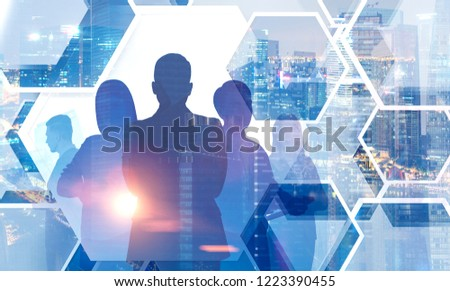 Silhouettes of manager team members standing together over cityscape background. Concept of teamwork. Toned image double exposure