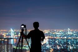 Silhouettes of many photographers. Beautiful Colorful blurs boke