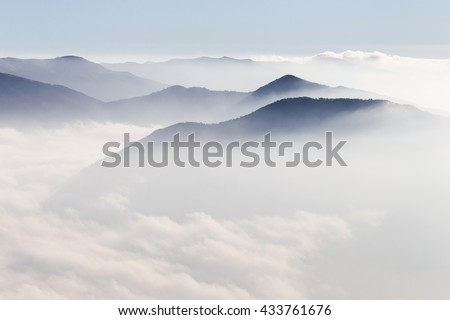 Silhouettes of mountains in the mist #433761676