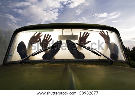 silhouettes of passengers in car full of smoke